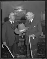 John A. McNaughton showing Mayor Shaw a ten-gallon hat, Los Angeles, 1935