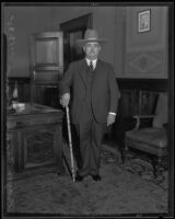Mayor Frank Shaw posing with a stockman's cane and a ten-gallon hat, Los Angeles, 1935