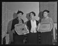 Verna McConnell and Dorothy Hadsell hold silver trays that Mrs. Selwyn Douglas made, Los Angeles, 1935