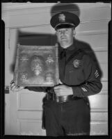 Sargent Wallace E. Lund designs bronze L. A. P. D. plaque, Los Angeles, 1935
