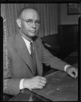 Roscoe Edwin Shonerd reviews blueprints, Los Angeles County, 1935