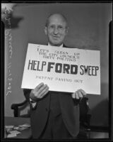 C. M. Pierce holds a sign in solidarity with the street sweeper strike, Los Angeles, 1935