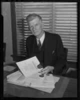 Dean Rockwell D. Hunt at his desk, Los Angeles, 1935