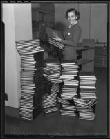 Virginia Hudson and stacks of books, Los Angeles, 1935