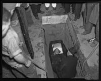 Gloria Graves is dug up from her steel tomb, Los Angeles, 1935