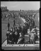 Graduates of Loyola College proceed in a line to walk at commencement, Los Angeles, 1935