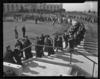 Graduates of Loyola College walk away from commencement ceremony, Los Angeles, 1935
