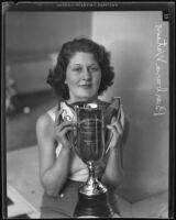Teenager Barbara Watson with her beauty contest trophy, San Diego, 1935
