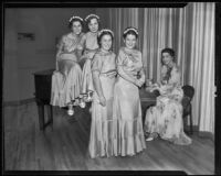 Frances C. Potts at piano as high school students Molly Cooley, Betty Wetmore, Jeanne Chanslor, and Persis Kent prepare to perform, Los Angeles, 1935