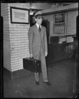 Leslie B. Henry standing outside of deputy jailer's work space, 1930s