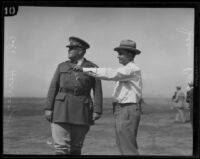 Colonel Harcourt Hervey and Eugene Biscailuz on golf course, Los Angeles