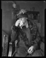 Mrs. Eva Hickman, mother of murderer William Edward Hickman, cries into a handkerchief, Los Angeles, 1928