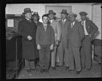 William Edward Hickman, convicted for murder of Marion Parker, poses with officers, Los Angeles, 1928