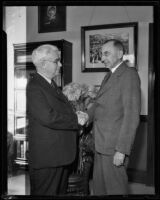 J. R. Hitchcock and H. P. Anewalt of Santa Fe Railroad shaking hands, Los Angeles, 1932