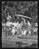 Swimming mermaid Marion Himmelstein preparing to dive, Los Angeles, 1925