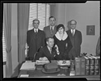 Ex-Judge Guy F. Bush and wife Leila LeGrand with attorneys Hahn, Holbrook and Bole at Hahn's office, Los Angeles, 1935