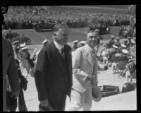 Herbert Hoover and George E. Cryer walk up City Hall steps, Los Angeles, 1928