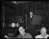 Herbert Hoover speaking in front of flag, Los Angeles, 1930s