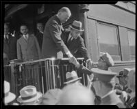 Herbert Hoover greets crowd gathered at train, Southern California, ca. 1928