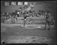 Athlete Bud Houser throwing a discus at the Coliseum, Los Angeles, 1922-1926