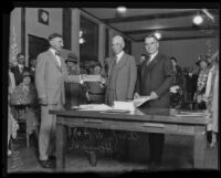 Sam L. Kreider and Marshall Stimson present award to W. H. Housh, Los Angeles, 1925