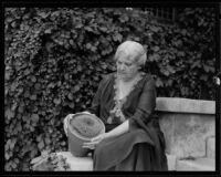 Mrs. Albert Sherman Hoyt posing with cactus plant, South Pasadena, 1931