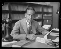 George Howard at his desk, Los Angeles