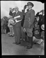 Governor Merriam and General Seth Howard salute during Armistice Day celebration, Los Angeles, 1934