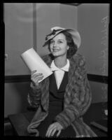 Actress Rochelle Hudson posing with a script [?] or contract [?], 1935
