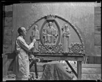 Sculptor Frederick P. Humphrey working on bas-relief of Christ in Majesty, Pasadena, 1932