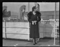 Barbara Hutton on a ship holding gloves, San Pedro (Los Angeles), 1930s