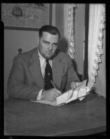 David Hutton holding telegrams, Los Angeles, 1932