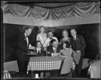 David Hutton and Kitty Chapman drinking at table with friends at a club, Los Angeles, 1933