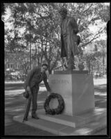 Otto Klemperer laying a wreath at Beethoven Statue in Pershing Square, Los Angeles, 1933