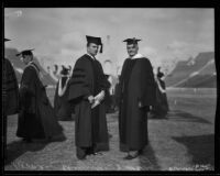 Norman Chandler and Harry Chandler at a graduation ceremony at the Memorial Coliseum, Los Angeles, 1930s