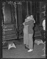 Trojan fullback Inky Wotkyns with wife, Helen, before leaving for Chicago, Los Angeles, 1935