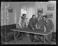 Captain Wesley White demonstrates polo strategies to Charlie Farrell, Frank Borzage, and Johnny Mack Brown, Los Angeles, 1935