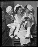Mrs. Mary V. Squires with her children in a Small Claims court, Los Angeles, 1935