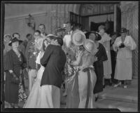 Guests surrounding Doris MacMahon and Hallam Cooley on their wedding day, Los Angeles, 1935