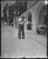 Twelve-year-old Tom Coyle exhibits roping skills, Los Angeles, 1935