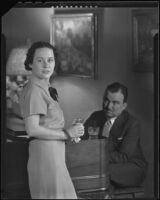 George Sprague seated at a piano, and an unidentified woman, circa 1930-1939