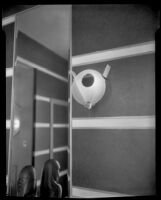"""View of an art deco sconce and wall paneling in """"Irene LTD,"""" a dress shop of designer Irene Lentz Gibbons, Los Angeles, (circa 1930?)"""