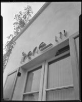 """Sign reading """"irene LTD"""" on the outside of a dress shop of designer Irene Lentz Gibbons, Los Angeles, (circa 1930?)"""