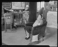Woman with cat, probably the wife of artist Stanley Reckless, in the studio of their Silver Lake home, Los Angeles, 1930-1939