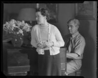 Stanley Reckless, seated at a piano, with his wife (?) in his Silver Lake home, Los Angeles, 1930-1939