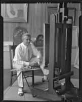 Stanley Reckless painting in the studio of his Silver Lake home, Los Angeles, 1930-1939