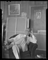 Stanley Reckless seated in the studio of his Silver Lake home, Los Angeles, 1930-1939
