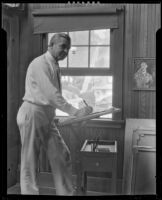 Stanley Reckless drawing in the studio of his Silver Lake home, Los Angeles, 1930-1939