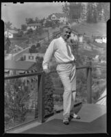 Stanley Reckless standing on a balcony of his home overlooking in the Silver Lake neighborhood, Los Angeles, 1930-1939
