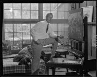 Paul Sample working on a painting in his studio, Pasadena, circa 1935